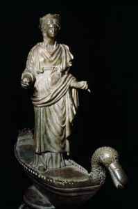 GODDESS OF THE RIVER SEINE A bronze figurine of the Goddess Sequana in flowing robes on a boat with its prow shaped like the head of a duck.